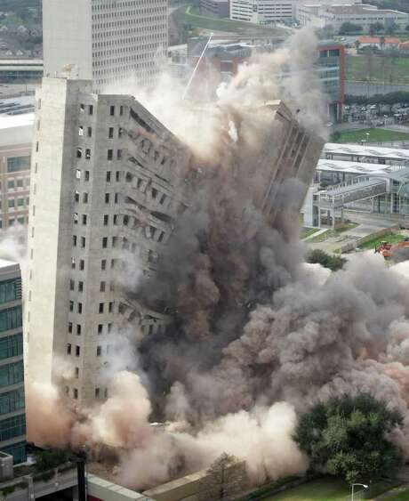 M.D. Anderson's Houston Main Building is imploded Sunday, Jan. 8, 2012, in Houston. Opened in 1952, the 20-story building was the regional headquarters for Prudential Insurance Company. Prudential sold the building in 1975.  (AP Photo/Houston Chronicle, Nick de la Torre) MANDATORY CREDIT Photo: AP