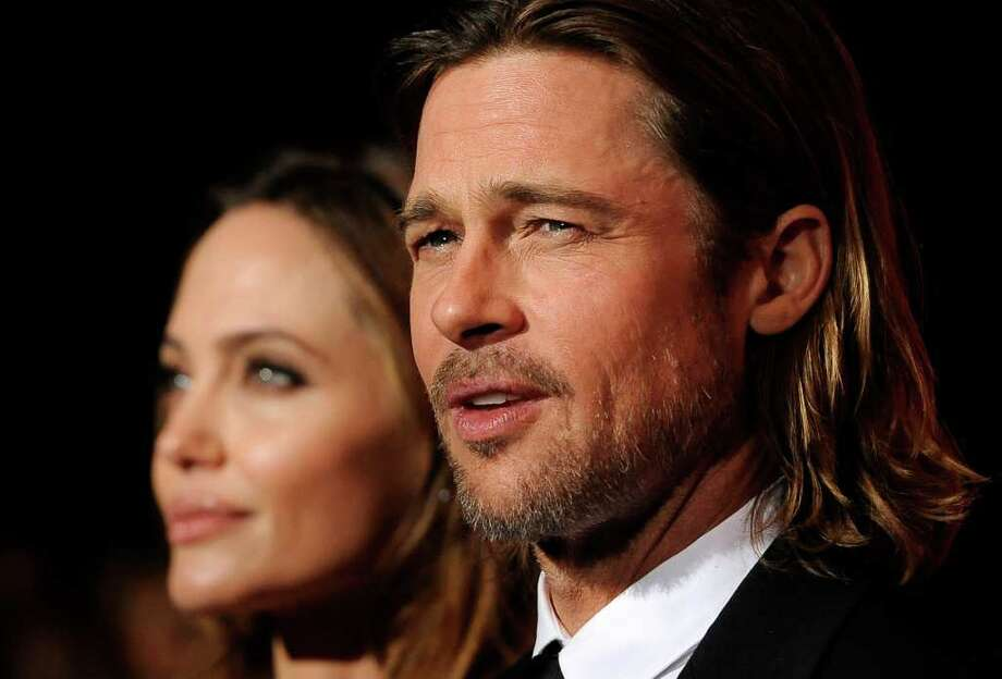Brad Pitt, recipient of the Desert Palm Achievement Award Actor, poses with Angelina Jolie at the 2012 Palm Springs International Film Festival Awards Gala, Saturday, Jan. 7, 2012, in Palm Springs, Calif. (AP Photo/Chris Pizzello) Photo: Chris Pizzello