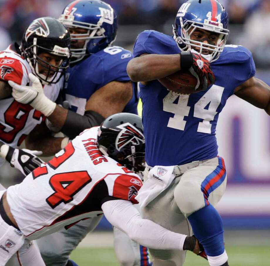Atlanta's Dominique Franks (24) tries to tackle Giants running back Ahmad Bradshaw (44) during the second half. Photo: AP