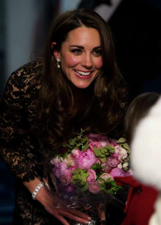 The Duchess of Cambridge talks to a guest after being presented with her bouquet as she arrives for the UK Premiere of 'War Horse' in aid of The Foundation of Prince William and Prince Harry, at a central London cinema, London, Sunday, Jan. 8, 2012. (AP Photo/Ian Gavan, Pool) Photo: Ian Gavan / POOL GETTY