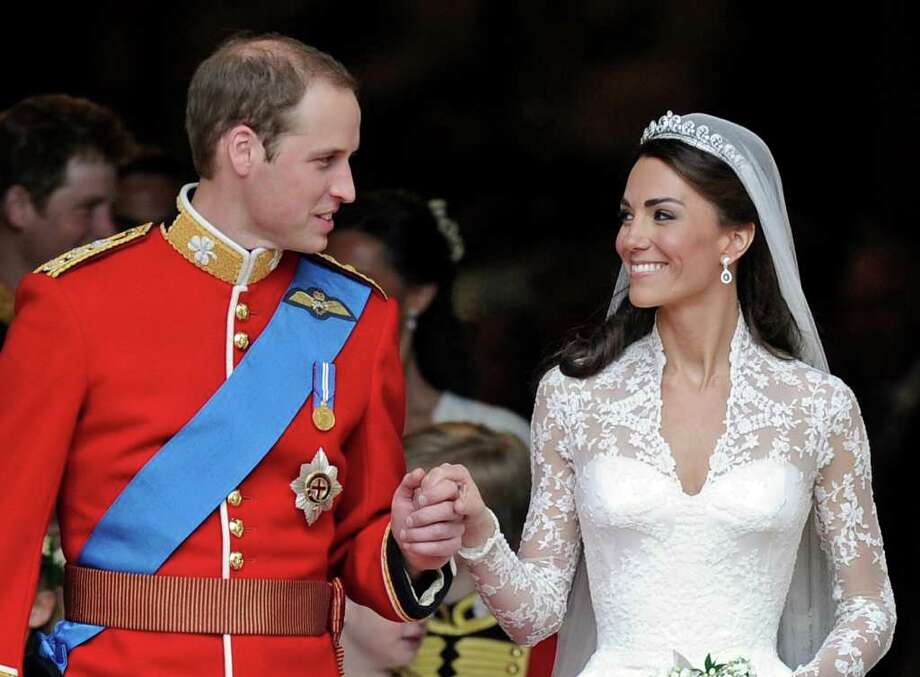 FILE - In this April 29, 2011 file photo, Britain's Prince William and his wife Kate, Duchess of Cambridge stand outside of Westminster Abbey after their Royal Wedding in London. The Duchess of Cambridge is turning 30 on Monday, Jan. 9, 2011 - but royal fans expecting a lavish birthday bash to mark the milestone will be disappointed. (AP Photo/Martin Meissner, File) Photo: Martin Meissner / AP