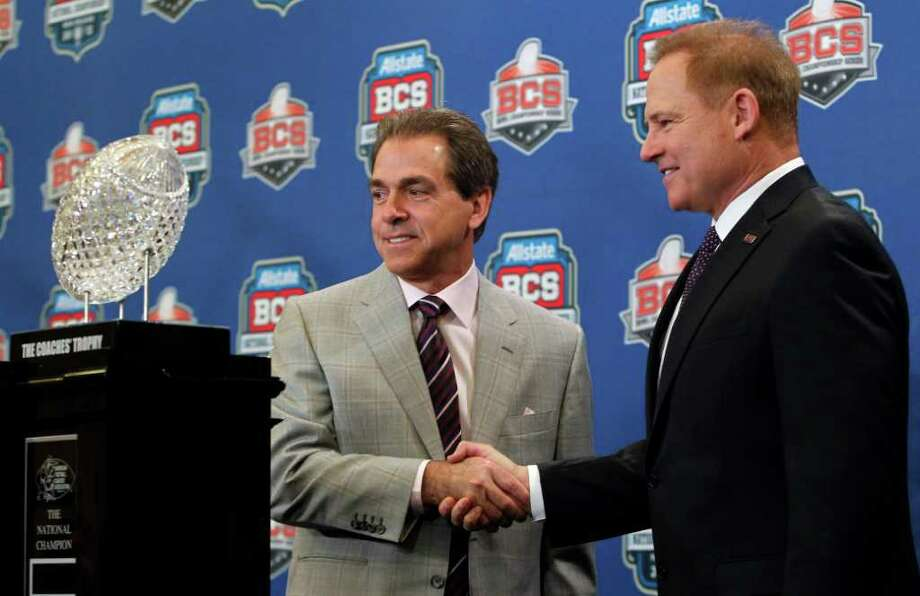 LSU head coach Les Miles, right, shakes hands with Alabama head coach Nick Saban during a news conferemce for the BCS National Championship college football game Sunday, Jan. 8, 2012, in New Orleans. (AP Photo/Dave Martin) Photo: Dave Martin