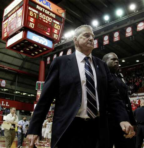 Connecticut head coach Jim Calhoun walks off the court after losing to Rutgers 67-60 in an NCAA college basketball game in Piscataway, N.J., Saturday, Jan. 7, 2012. (AP Photo/Mel Evans) Photo: Mel Evans, Associated Press / AP