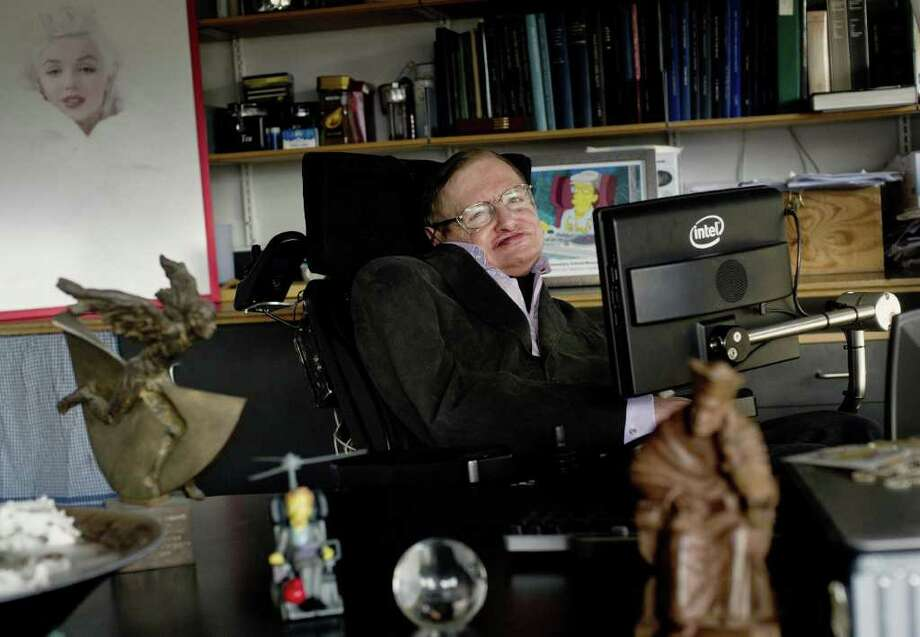 In this December 2011 photo made available by the Science Museum, Professor Stephen Hawking sits in his office at University of Cambridge, in Cambridge, England. The University of Cambridge says renowned physicist Hawking isn't well enough to attend a conference held to celebrate his 70th birthday. Hawking's remarkable career is being honored Sunday, Jan. 8, 2012, as part of a daylong conference on cosmology being hosted at the university. (AP Photo/Science Museum, Sarah Lee) Photo: Sarah Lee