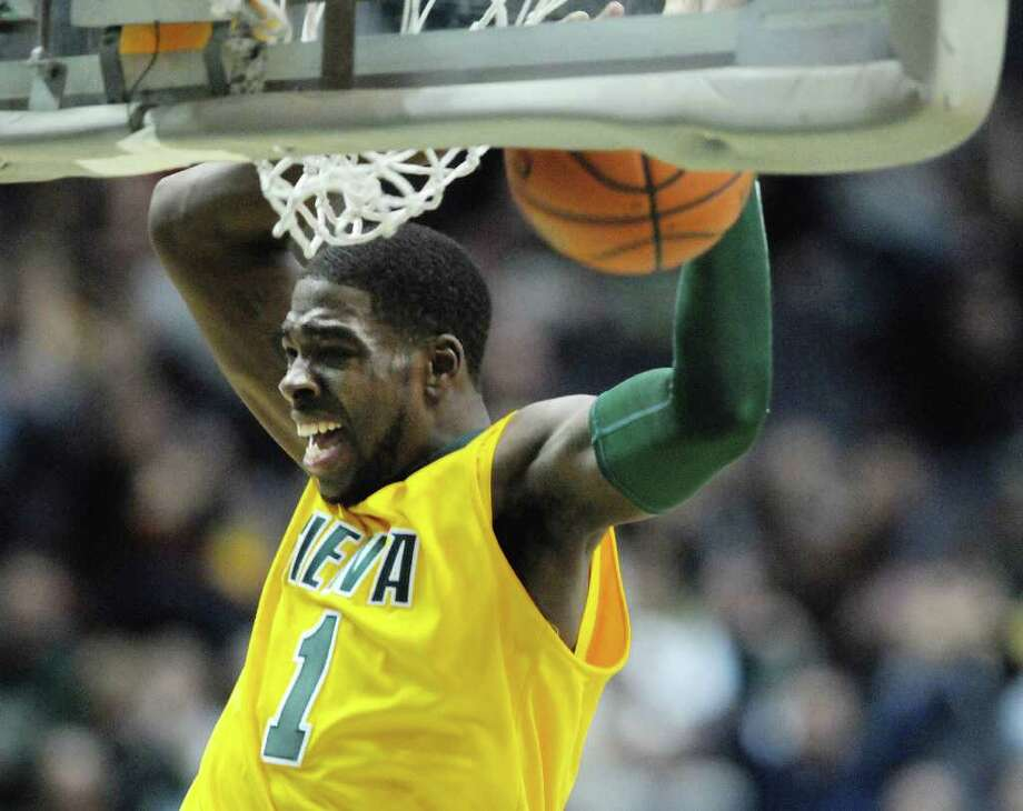 OD Anosike of Siena dunks the ball during their game against Niagara  at the Times Union Center on Sunday, Jan. 8, 2012 in Albany.   (Paul Buckowski / Times Union) Photo: Paul Buckowski