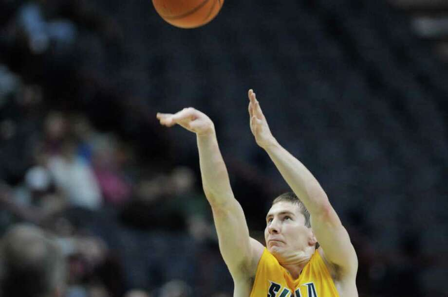 Kyle Downey of Siena puts up a shot  during their game against Niagara at the Times Union Center on Sunday, Jan. 8, 2012 in Albany.   (Paul Buckowski / Times Union) Photo: Paul Buckowski