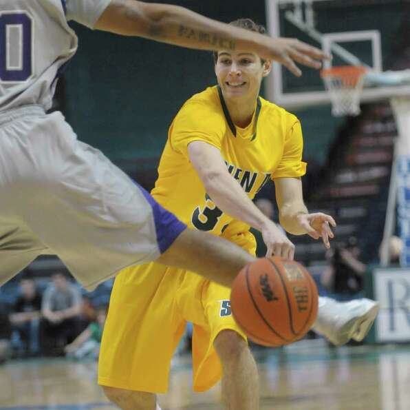 Rob Poole of Siena passes around a  Niagara player during their game at the Times Union Center on Su