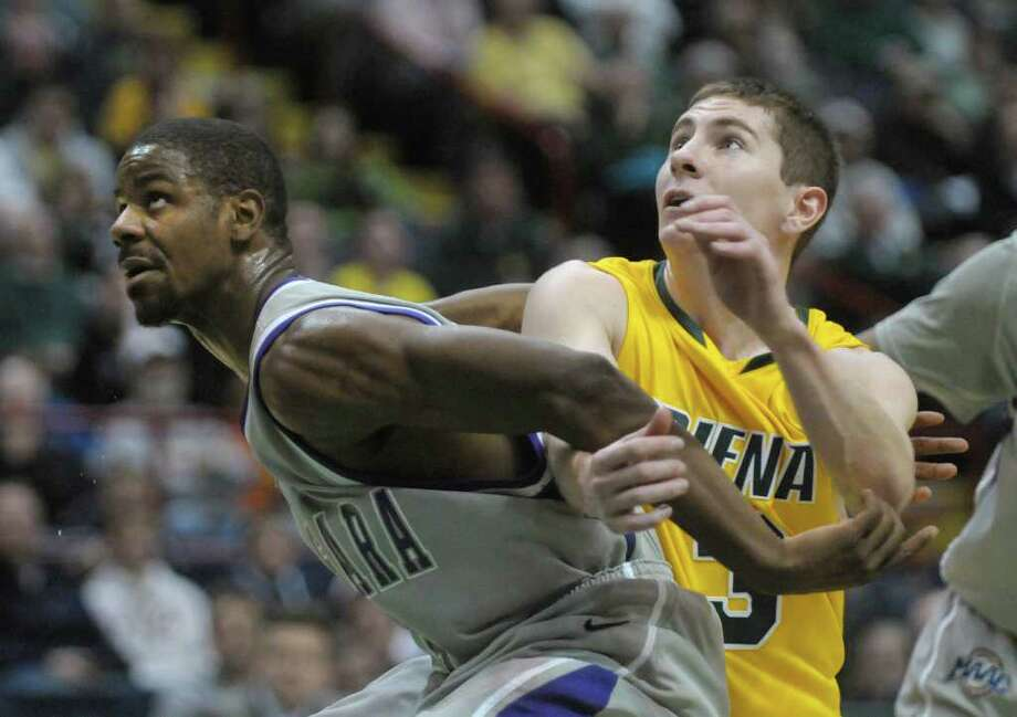 Ameen Tanksley of Niagara, left, boxes out Kyle Downey of Siena during their game at the Times Union Center on Sunday, Jan. 8, 2012 in Albany.   (Paul Buckowski / Times Union) Photo: Paul Buckowski