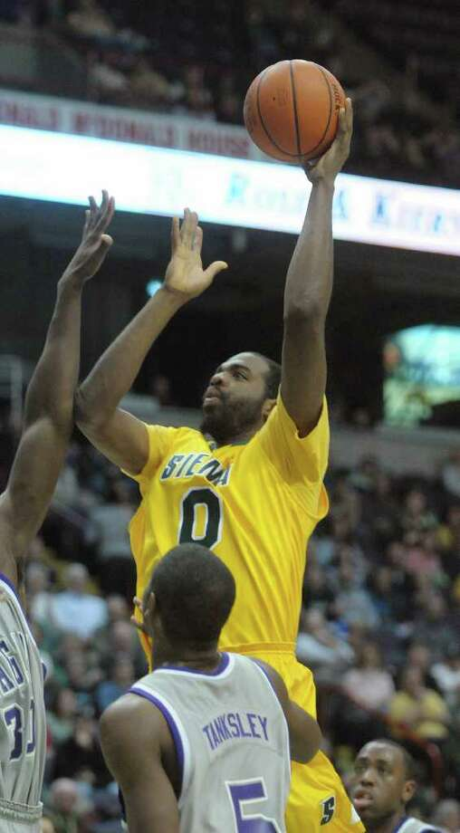 Brandon Walters of Siena puts up a shot over Niagara players during their game at the Times Union Center on Sunday, Jan. 8, 2012 in Albany.   (Paul Buckowski / Times Union) Photo: Paul Buckowski