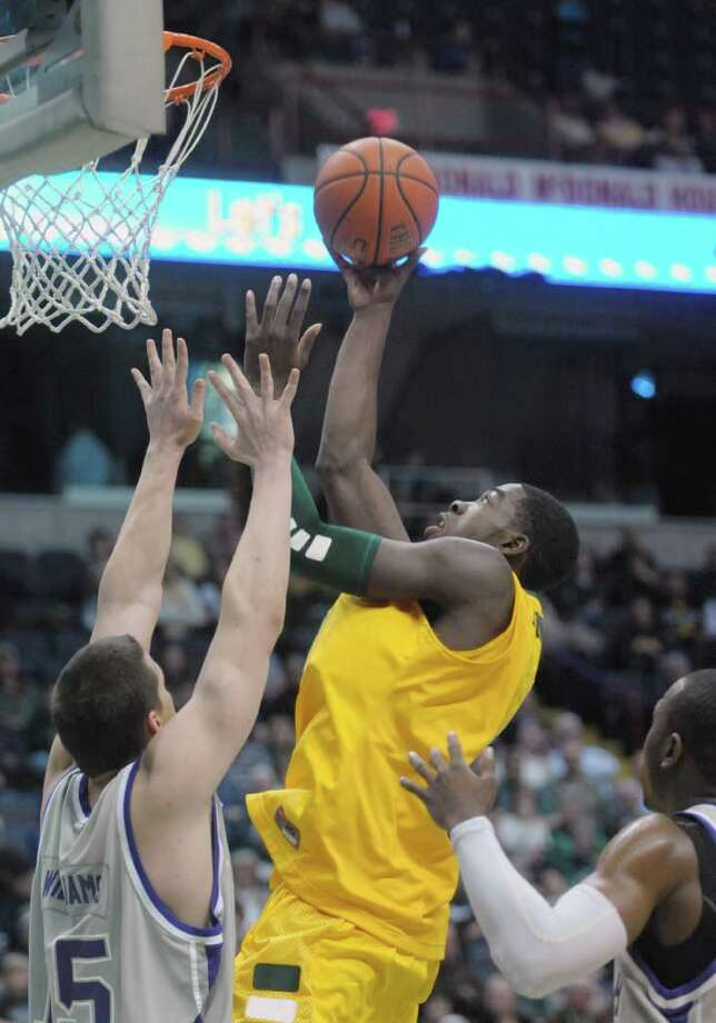 OD Anosike of Siena puts up a shot over a  Niagara defender after Anosike scored a basket during their game at the Times Union Center on Sunday, Jan. 8, 2012 in Albany.   (Paul Buckowski / Times Union) Photo: Paul Buckowski