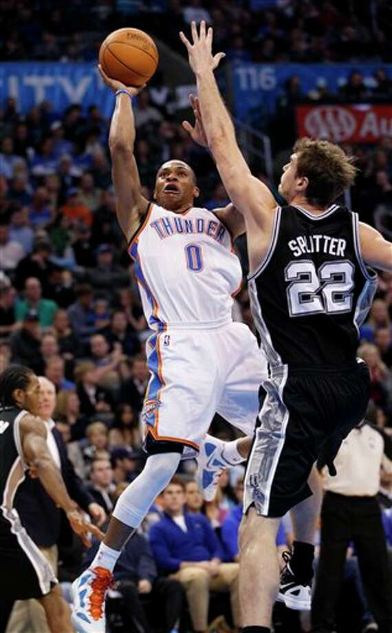 Oklahoma City Thunder guard Russell Westbrook (0) shoots in front of San Antonio Spurs forward Tiago Splitter (2), of Brazil, in the third quarter of an NBA basketball game in Oklahoma City, Sunday, Jan. 8, 2012. Oklahoma City won 108-96. (AP Photo/Sue Ogrocki) Photo: Sue Ogrocki, Associated Press / AP