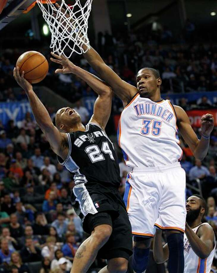 Oklahoma City Thunder forward Kevin Durant (35) fouls San Antonio Spurs guard Richard Jefferson (24) as Jefferson goes up for a shot in the second quarter of an NBA basketball game in Oklahoma City, Sunday, Jan. 8, 2012. Oklahoma City won 108-96. (AP Photo/Sue Ogrocki) Photo: Sue Ogrocki, Associated Press / AP
