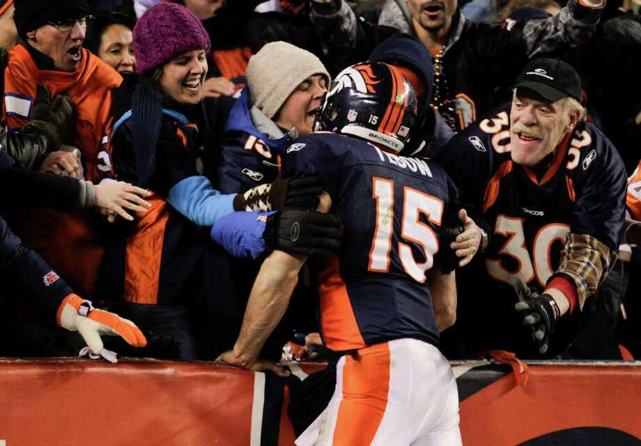 Denver Broncos quarterback Tim Tebow (15) celebrates with fans after wide receiver Demaryius Thomas (88) caught a pass for an 80-yard touchdown to win the game against the Pittsburgh Steelers in overtime of an NFL wild card playoff football game Sunday, Jan. 8, 2012, in Denver.  (AP Photo/Joe Mahoney) Photo: Joe Mahoney