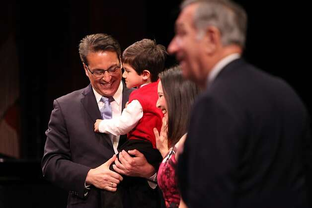 "Sheriff Ross Mirkarimi holds his son Theo with his wife Eliana Lopez by his side after being sworn in by Former Mayor Art Agnos, Sunday January 8, 2012, in San Francisco, Calif. When ask about the investigation of domestic violence involving his wife, both she and he replied, "" this is a personal issue."" Photo: Lacy Atkins, The Chronicle"