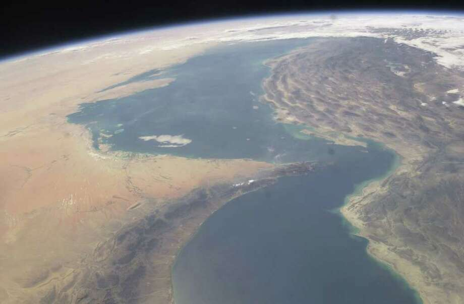 This image provided by NASA shows the Strait of Hormuz taken from the International Space Station in Sept. 30, 2003. An Iranian newspaper quotes a senior commander in Iran's Revolutionary Guard Sunday Jan. 8, 2012 as saying that Tehran's leadership has decided to order the closure of the strategic Strait of Hormuz at the mouth of the Persian Gulf if the country's oil exports are blocked. (AP Photo/NASA)