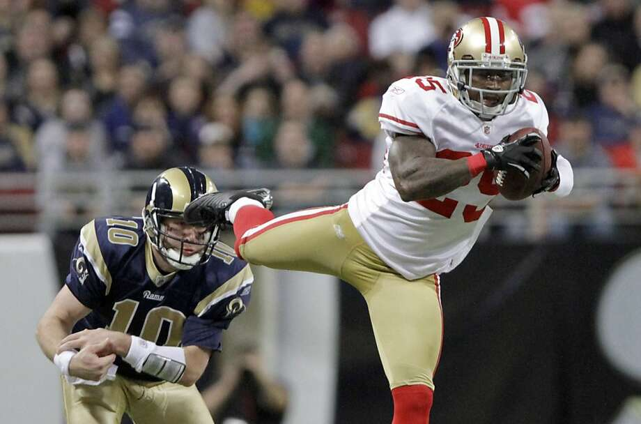 San Francisco 49ers cornerback Tarell Brown, right, intercepts a pass intended for St. Louis Rams' Kellen Clemens, left, during the second quarter of an NFL football game Sunday, Jan. 1, 2012, in St. Louis. (AP Photo/Seth Perlman) Photo: Seth Perlman, Associated Press