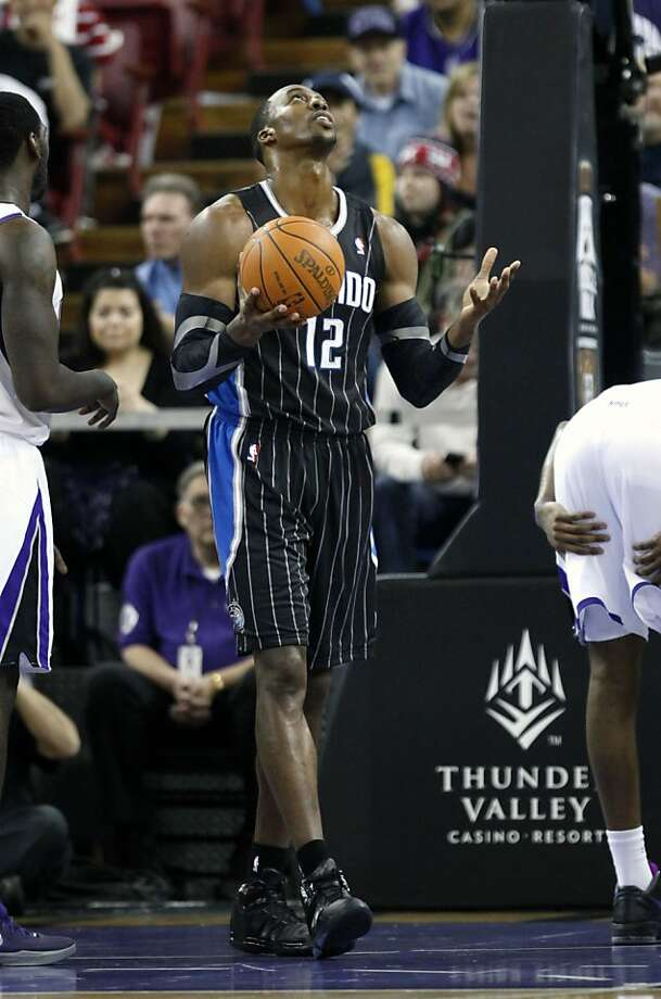 Orlando Magic center Dwight Howard looks skyward after being called for a foul during the third quarter against the Sacramento Kings in a NBA basketball game in Sacramento, Calif., Sunday, Jan. 8, 2012.  Howard spent much of the game on the bench with foul problems and finished with four fouls in the Magic's 104-97 win over the Sacramento Kings.(AP Photo/Rich Pedroncelli) Photo: Rich Pedroncelli, Associated Press