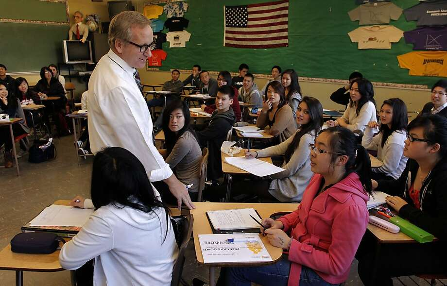 INstructor, James Spellicy, teaches an advanced placement economics class at Lowell High School in San Francisco, Ca., on Thursday Jan. 5, 2012.  High school student are increasingly loading up on advanced placement classes to increase their grade point average on college applications, but critics say the loads are to heavy and stressful and that policies should limit the number students can take. Photo: Michael Macor, The Chronicle