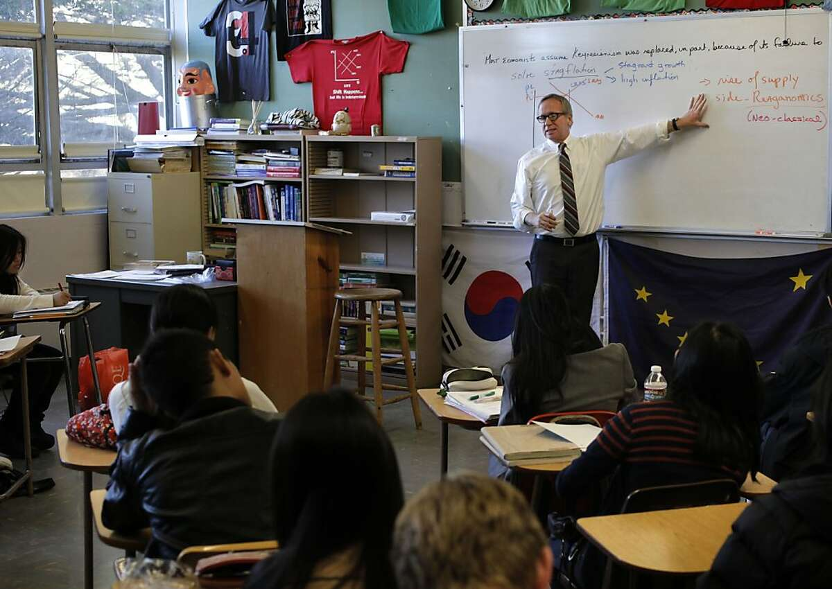 Instructor, James Spellicy, teaches an advanced placement economics class at Lowell High School in San Francisco, Ca., on Thursday Jan. 5, 2012. High school student are increasingly loading up on advanced placement classes to increase their grade point average on college applications, but critics say the loads are to heavy and stressful and that policies should limit the number students can take.