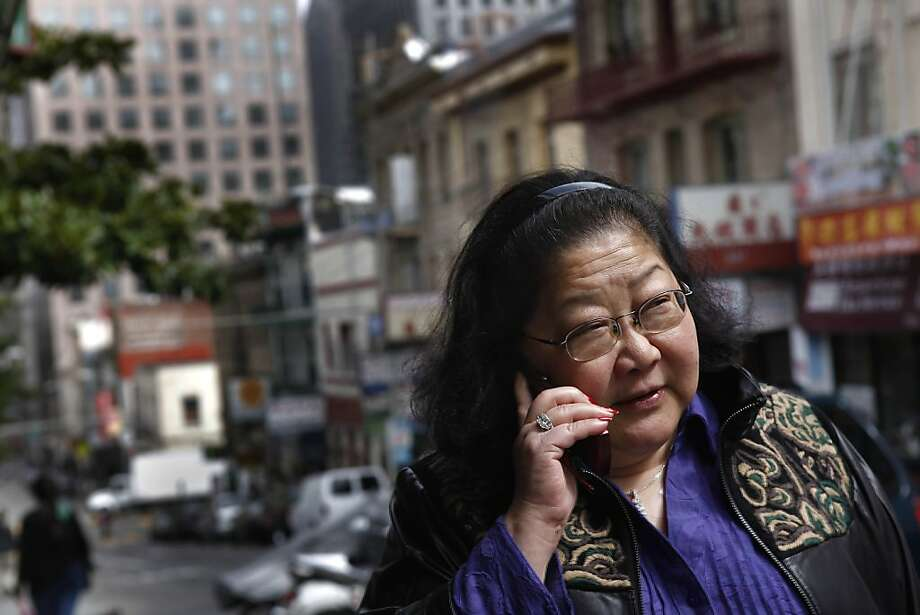 Rose Pak talks on her cell phone as she walks up Clay Street in Chinatown in San Francisco, Calif. on Friday September 17, 2010. Photo: Lea Suzuki, The Chronicle