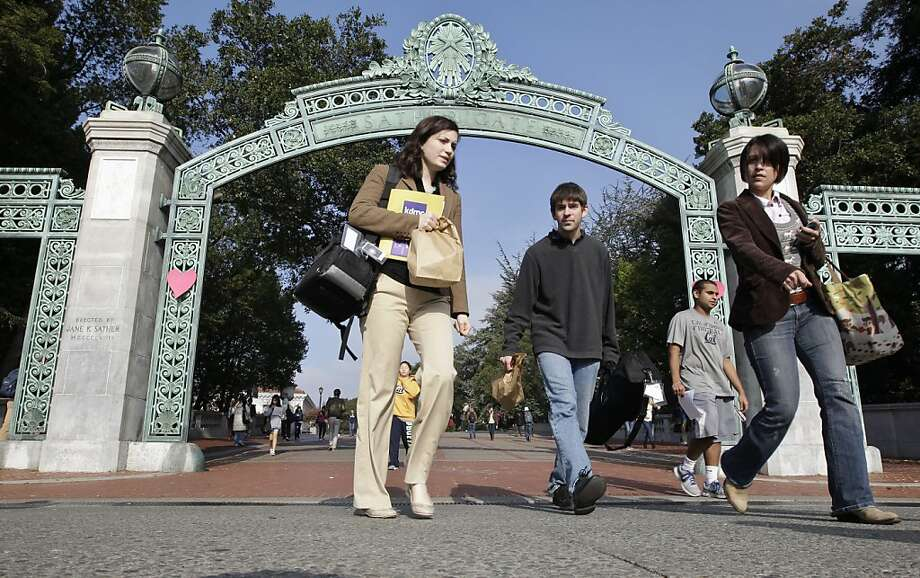 University of California, Berkeley students walk through Sather Gate on the Berkeley, Calif., campus, Wednesday, Dec. 14, 2011. Chancellor Robert Birgeneau announces a middle-class financial aid plan during a news conference for families whose gross income ranges from $80,000 to $140,000 annually. The new plan caps the contribution parents make towards the annual cost of a UC Berkeley's student's education at 15 per cent of their earnings. (AP Photo/Paul Sakuma) Photo: Paul Sakuma, Associated Press