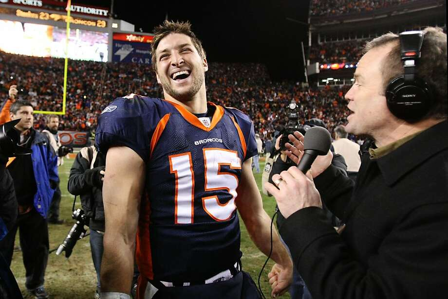 DENVER, CO - JANUARY 08:  Tim Tebow #15 of the Denver Broncos talks to the media after defeating the Pittsburgh Steelers in overtime of the AFC Wild Card Playoff game at Sports Authority Field at Mile High on January 8, 2012 in Denver, Colorado. The Denver Broncos defeated the the Pittsburgh Steelers in overtime 23 - 29.  (Photo by Jeff Gross/Getty Images) Photo: Jeff Gross, Getty Images