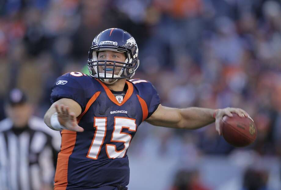 Denver Broncos quarterback Tim Tebow (15) throws against the PIttsburgh Steelers in the second quarter of an NFL wild card playoff football game Sunday, Jan. 8, 2012, in Denver.  (AP Photo/Joe Mahoney) Photo: Joe Mahoney, Associated Press