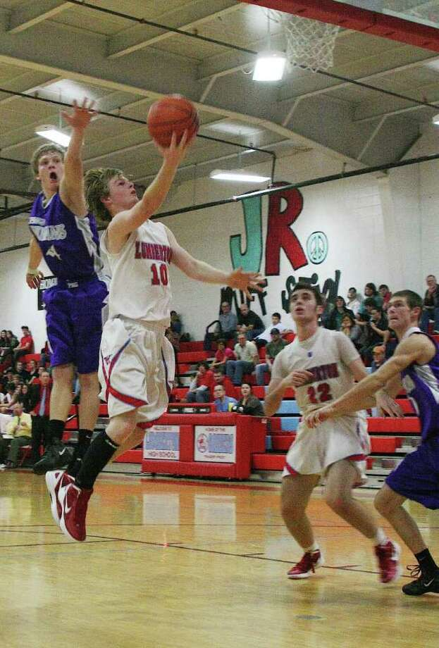 Raider Ryan Stanley soars for the score in Friday night's game against PN-G. Although the first half remained close, the Indians ultimately ended the night with a 53-30 win. Photo: David Lisenby, HCN_Lbt Vs PNG 2