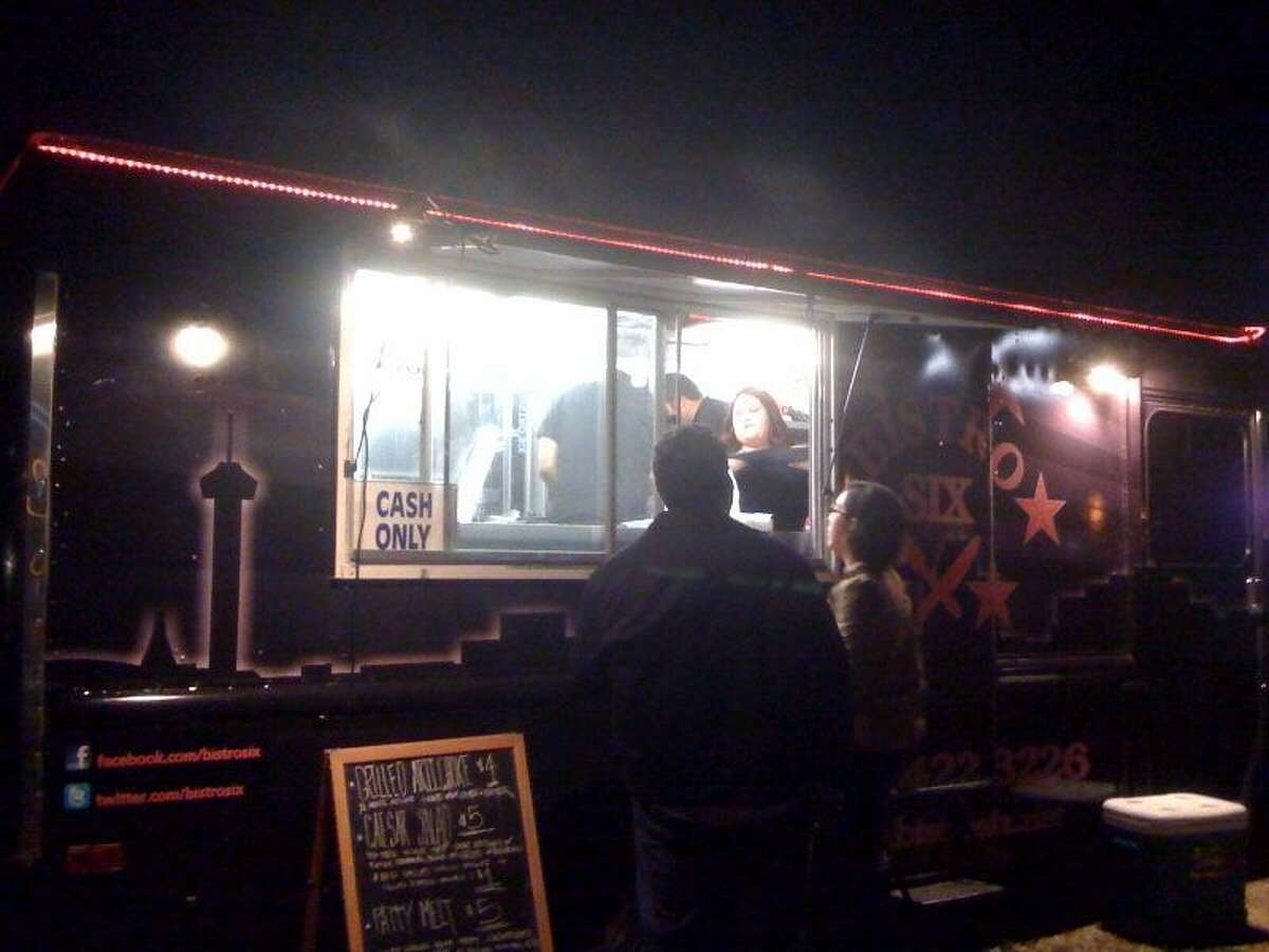 Customers place an order at the Bistro Six mobile food truck in Southtown last Friday. Photo by Noi Mahoney