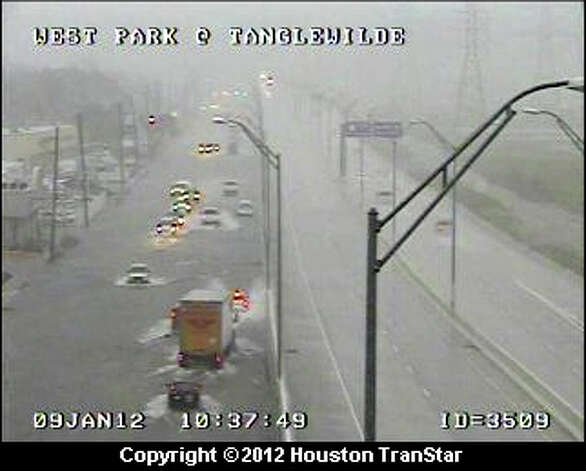 Flooding on Westpark at Tanglewilde about 10:30 a.m. Photo: (Houston TranStar)