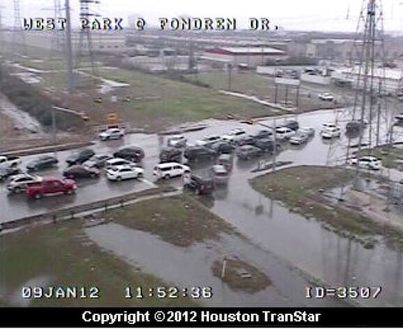 High-water traffic jam at Westpark and Fondren around noon. Photo: (Houston TranStar)