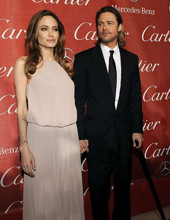 Angelina Jolie and Brad Pitt pose together at the 2012 Palm Springs International Film Festival Awards Gala, Saturday, Jan. 7, 2012, in Palm Springs, Calif. (AP Photo/Chris Pizzello) Photo: Chris Pizzello, Associated Press