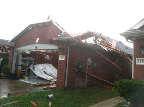 A house near Sugar Land after it was hit by a tornado on Monday, Jan. 9, 2011. Photo: (James Nielsen / Chronicle)