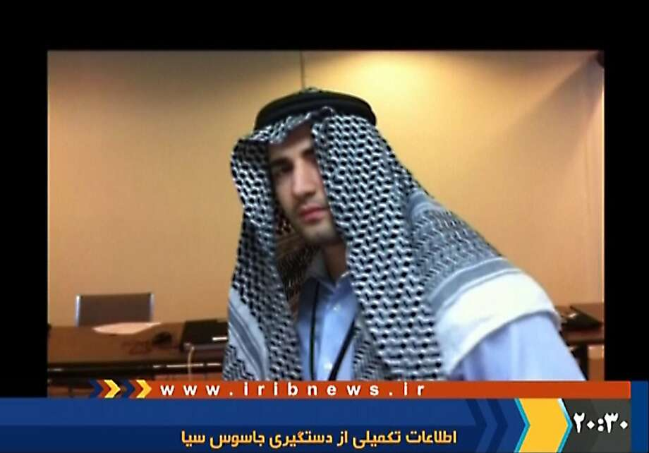 "(FILES)--A grab taken from a video aired by the official Iranian state TV on December 18, 2011 shows one of several photos of a young man alleged to be a captured CIA spy of Iranian origin confessing to a ""mission"" to infiltrate the intelligence ministry, wearing a traditional Arab garb. The television named the man as Amir Mirza Hekmati and said he was born in the US state of Arizona. The 28-year-old American ex-Marine, who also holds Iranian citizenship, has been sentenced to death by an Iran judge for spying for the CIA, the Fars news agency reported on Januray 9, 2012.    AFP PHOTO/HO RESTRICTED TO EDITORIAL USE - MANDATORY CREDIT "" AFP PHOTO / IRANIAN TV "" NO MARKETING NO ADVERTISING CAMPAIGNS - DISTRIBUTED AS A SERVICE TO CLIENTS EDS NOTE: AFP IS USING PICTURES FROM ALTERNATIVE SOURCES AS IT WAS NOT AUTHORISED TO COVER THIS EVENT, THEREFORE IT IS NOT RESPONSIBLE FOR ANY DIGITAL ALTERATIONS TO THE PICTURE'S EDITORIAL CONTENT, DATE AND LOCATION WHICH CANNOT BE INDEPENDENTLY VERIFIED == (Photo credit should read -/AFP/Getty Images) Photo: -, AFP/Getty Images"