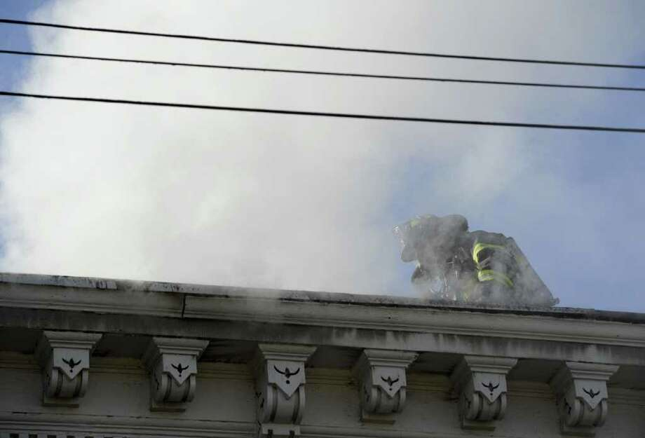 Albany firefighters work to put out a stubborn two-alarm fire at 502 Hudson Ave. in Albany, N.Y. Jan. 9, 2012.  ( Skip Dickstein/Times Union) Photo: Skip Dickstein / 2011