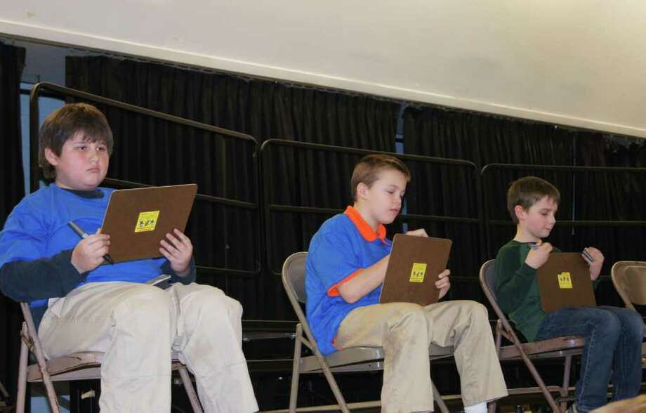 John Phipps, seated on the left, is one of the 54 finalists who will compete in the 2014 National Geographic Bee in Washington, D.C., on May 19 and 20. Photo: Contributed Photo