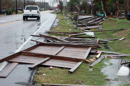 Fences damaged by a possible tornado on Gaines Road near Bissonnet Monday, Jan. 9, 2012, in Sugar Land. ( James Nielsen / Chronicle ) Photo: HC