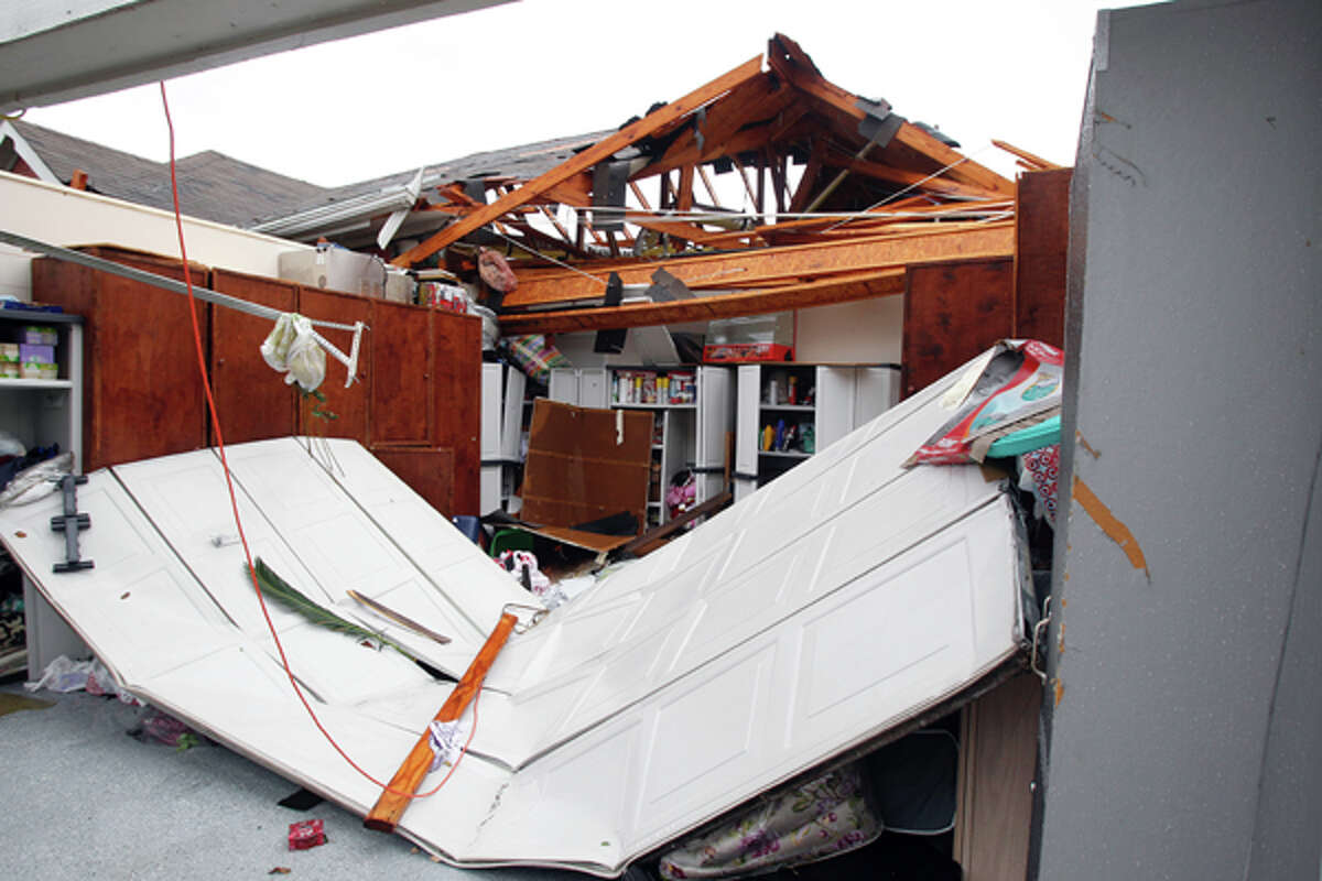 A home damaged by a possible tornado in the 15000 block of Turphin Way Monday, Jan. 9, 2012, in Sugar Land. ( James Nielsen / Chronicle )