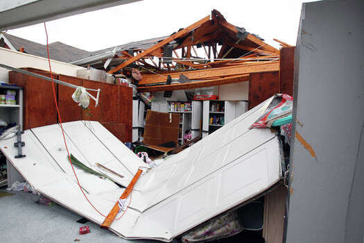 A home damaged by a possible tornado in the 15000 block of Turphin Way Monday, Jan. 9, 2012, in Sugar Land. ( James Nielsen / Chronicle ) Photo: HC