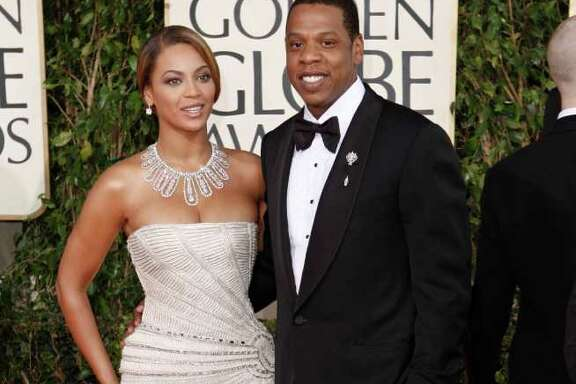 "FILE - In this Jan. 11, 2009 file photo, Beyonce, left, is joined by husband Jay-Z, as she arrives at the 66th Annual Golden Globe Awards in Beverly Hills, Calif. Through a rap verse, Jay-Z has confirmed the birth of ""the most beautiful girl in the world"" _ his newborn daughter.  The song ""Glory"" made its debut on his social website Monday, Jan. 9, 2012, two days after he and Beyonce reportedly gave birth to a daughter, Blue Ivy. (AP Photo/Matt Sayles, file)"