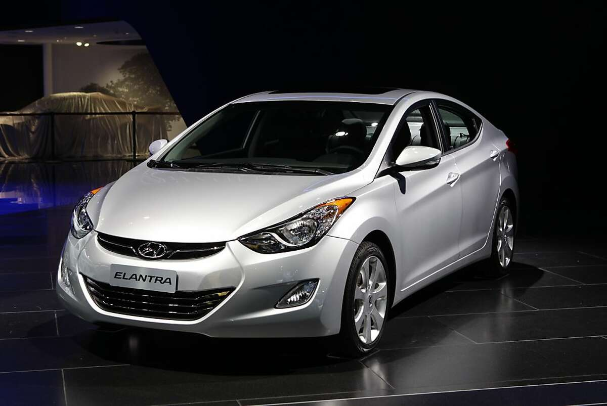 The 2012 Hyundai Elantra is shown at the North American International Auto Show in Detroit, Monday, Jan. 9, 2012. The Hyundai Elantra edged out the Ford Focus and Volkwagen Passat Monday, Jan. 9, 2012, to win the 2012 North American Car of the Year award.(AP Photo/Paul Sancya)
