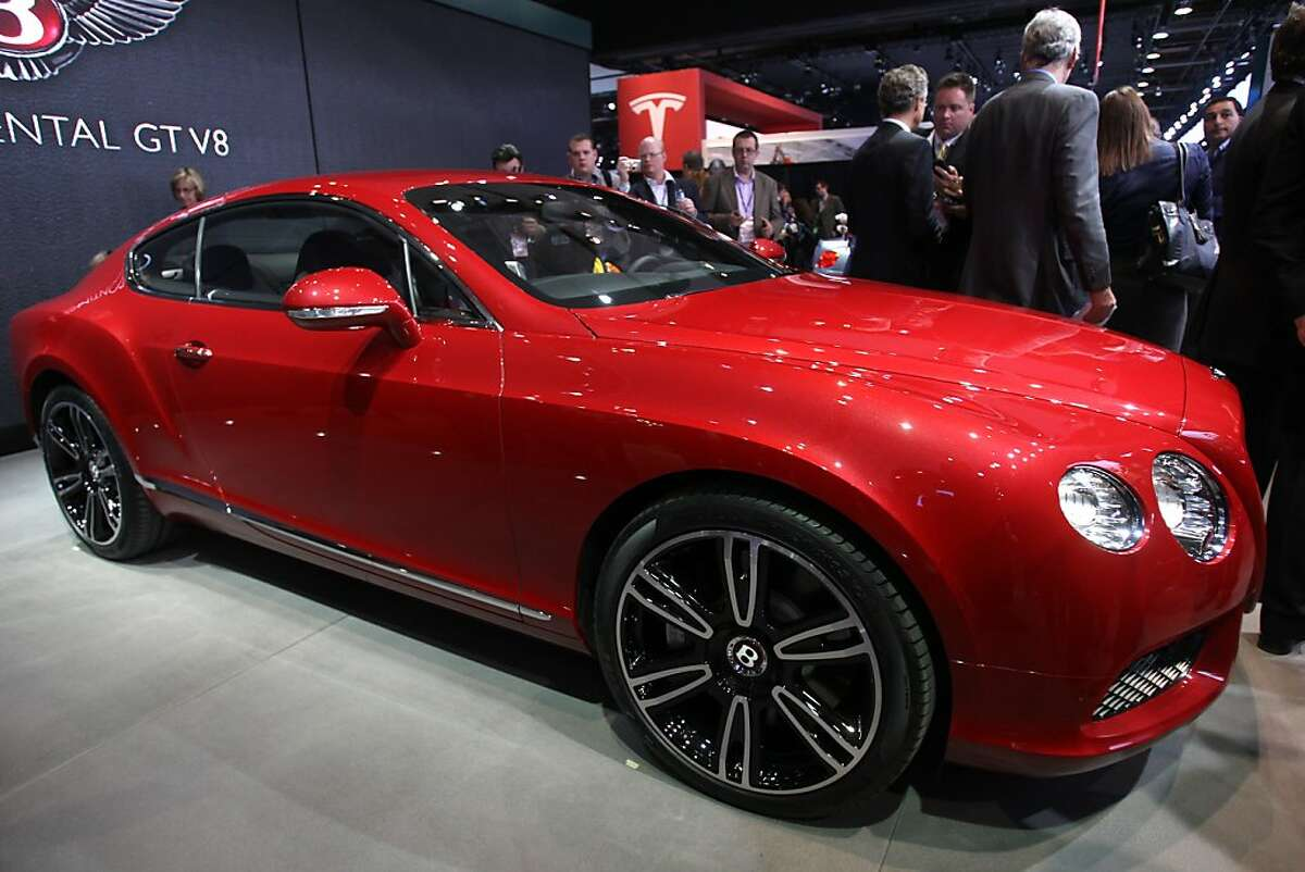 The Bentley New Continental GT V8 is introduced during the press preview of the 2012 North American International Auto Show in Detroit Michigan, January 9, 2012. AFP PHOTO/Geoff Robins (Photo credit should read GEOFF ROBINS/AFP/Getty Images)