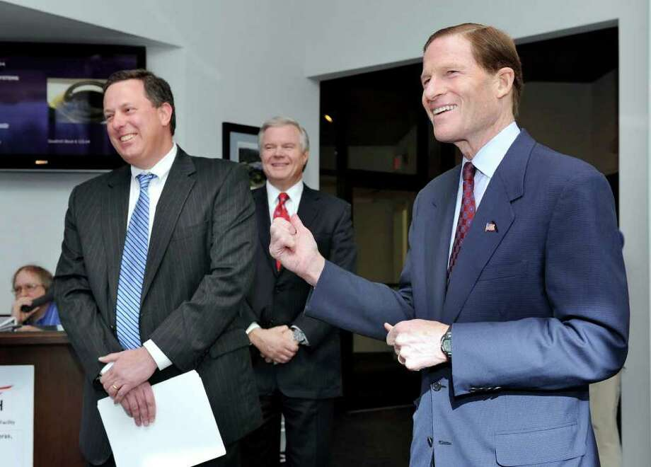 U.S. Sen. Richard Blumenthal, right, shares a joke with Andreas Nonnenmacher, left, vice president and general manager at Goodrich Corporation, and Rick Pyatte, vice president for government relations. Blumenthal was in Danbury Monday touring Goodrich as well as making several other stops. Photo taken Monday, January 9, 2012. Photo: Carol Kaliff / The News-Times