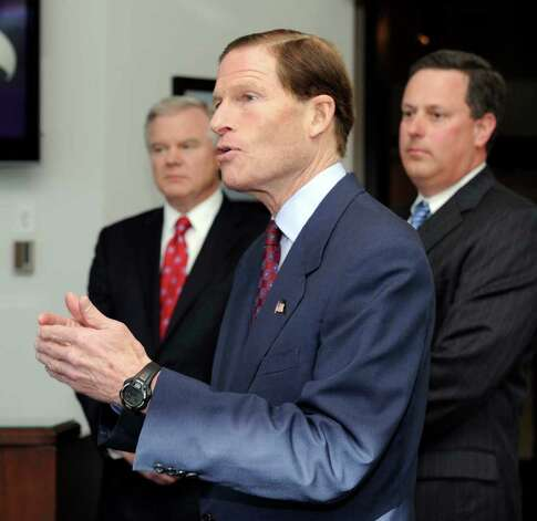 U.S. Sen. Richard Blumenthal, flanked by Rick Pyatt, left, vice president for government affairs at Goodrich Corporation, and Andreas Nonnenmacher, vice president and general manager, speaks at a press conference after touring the company on Monday. Photo taken Monday, January 9, 2012. Photo: Carol Kaliff / The News-Times