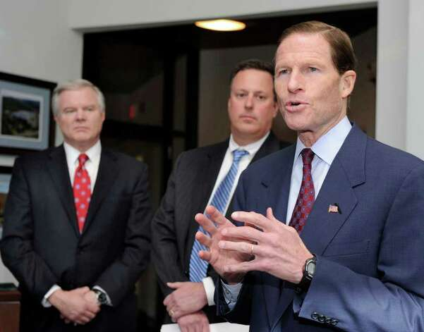 U.S. Sen. Richard Blumenthal, right, along with Andreas Nonnenmacher, left, vice president and general manager at Goodrich Corporation, and Rick Pyatte, vice president for government relations, addresses a press conference Monday after a tour of the facility. Photo taken Monday, January 9, 2012. Photo: Carol Kaliff / The News-Times