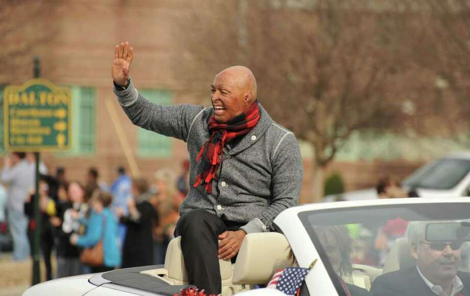 """Dancing With The Stars"" winner, J.R. Martinez, waves to fans as he is welcomed home with an honorary parade in Dalton, Ga., on Saturday, January 7, 2012. The parade went through downtown Dalton and a photo and autograph session was scheduled for 3:30 p.m. (AP Photo/Chattanooga Times Free Press, Ashlee Culverhouse) MANDATORY CREDIT Photo: AP"