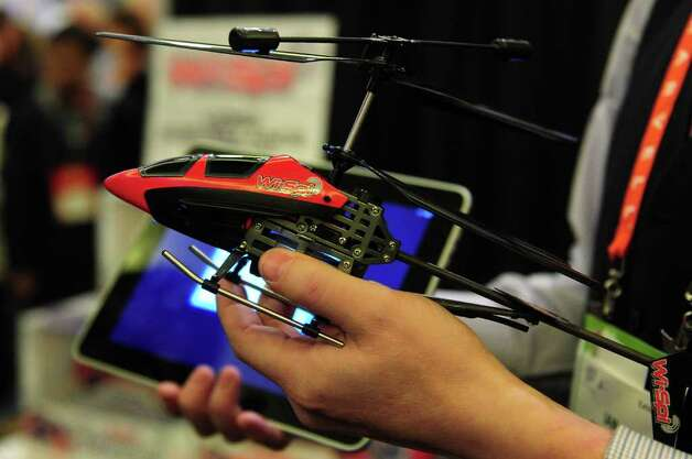 The Wi.Spi Helicopter, a video surveillance remote-controlled vehicle, is displayed at CES Unveiled, ahead of the opening of the annual Consumer Electronics Show on January 8, 2012 in Las Vegas, Nevada. Full remote control via Wi-Fi with Apple and Android compatibilty and Night Vision capabilities, the toy will be available at major toy and electronic retailers in the Fall of 2012. AFP PHOTO / Frederic J. BROWN Photo: FREDERIC J. BROWN, AFP/Getty Images / 2012 AFP
