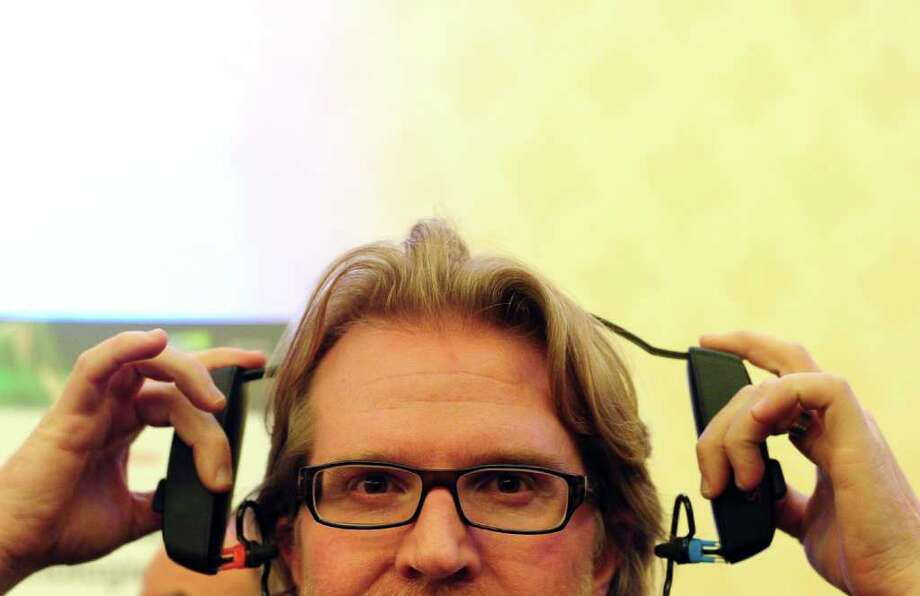 Nick Laperle displays a set of SonoFit custom-fitted earphones at CES Unveiled, ahead of the opening of the annual Consumer Electronics Show on January 8, 2012 in Las Vegas, Nevada. SonoFit earphones, which allow the user to create a pair of custom-fitted earphones in a 5-minute process, consist of patented earpieces, inflation pumps filled with medical-grade silicone bundled in a simple headband. AFP PHOTO / Frederic J. BROWN Photo: FREDERIC J. BROWN, AFP/Getty Images / 2012 AFP