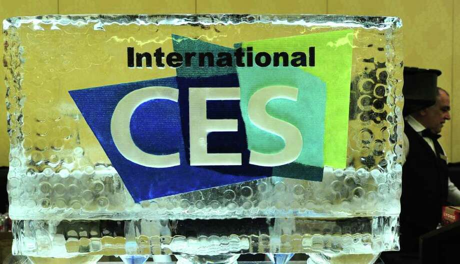 A waiter walks past a block of ice with event logo at CES Unveiled, ahead of the opening of the annual Consumer Electronics Show on January 8, 2012 in Las Vegas, Nevada.AFP PHOTO / Frederic J. BROWN Photo: FREDERIC J. BROWN, AFP/Getty Images / 2012 AFP