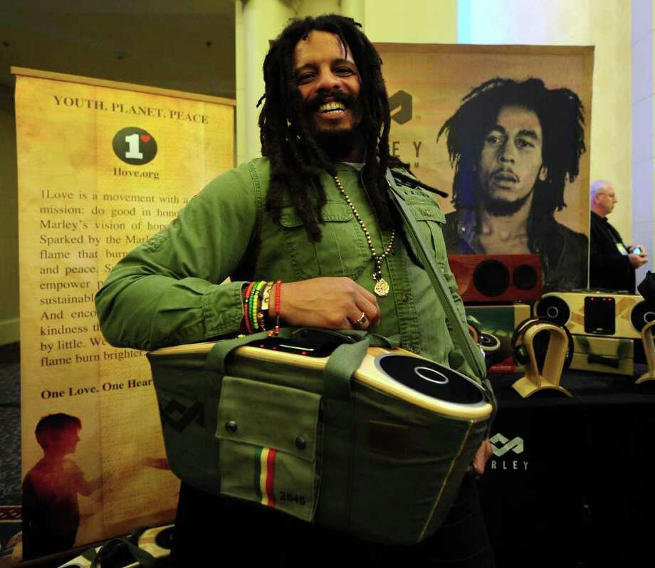 Rohan Marley, the son of late Reggae artist Bob Marley and Janet Hunt, displays the Bag of Rythym portable audio system from The House of Marley which plays music from any MP3 player at CES Unveiled, ahead of the opening of the annual Consumer Electronics Show on January 8, 2012 in Las Vegas, Nevada.  AFP PHOTO / Frederic J. BROWN Photo: FREDERIC J. BROWN, AFP/Getty Images / 2012 AFP
